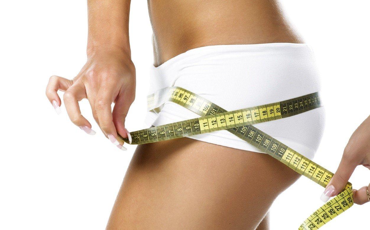 Woman measuring perfect shape of beautiful hips.jpg