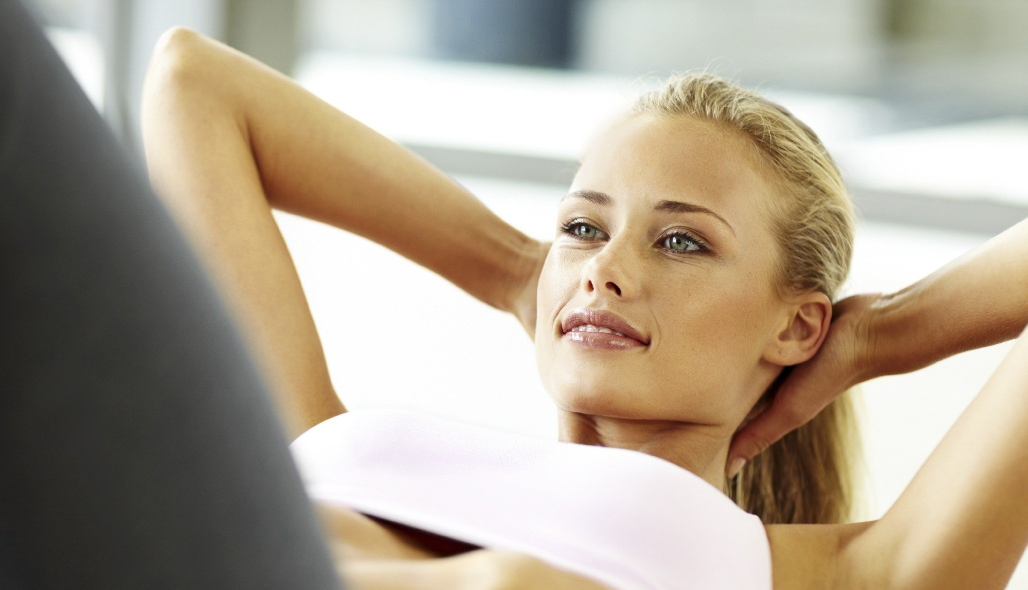 Fit young female doing abs exercise.jpg
